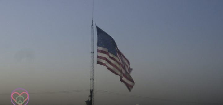 Image of American Flag flying at Dusk.
