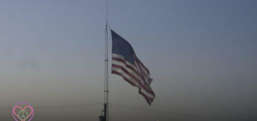 Image of American Flag flying at Dusk.